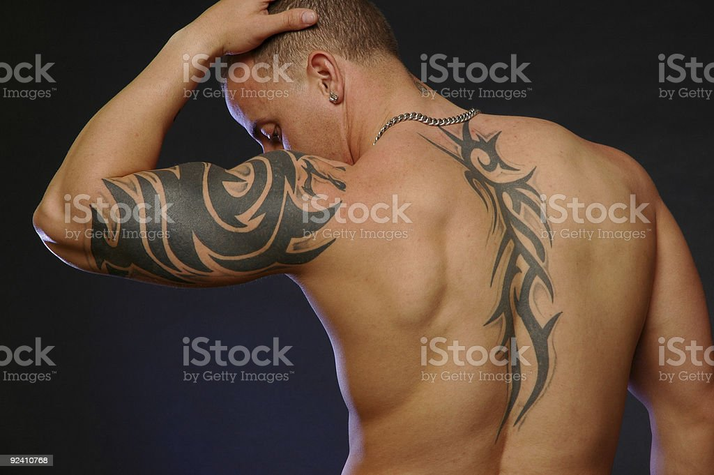 male with tribal tattoo's stock photo