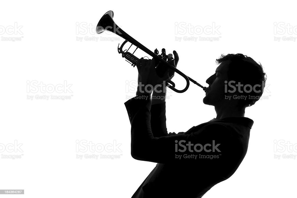Male with trumpet silhouette stock photo