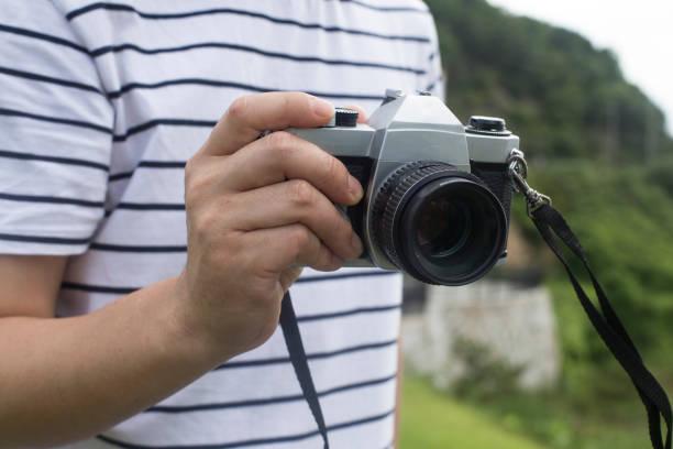 Male with vintage film camera picture id1167936782?b=1&k=6&m=1167936782&s=612x612&w=0&h=iwxhfo9c59qbvgtfkn6nxwq0eda1ex3nz lhyctk0km=