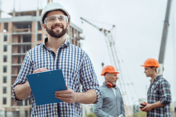 Male work building construction engineering occupation project Male work building construction engineering occupation writing engineer stock pictures, royalty-free photos & images