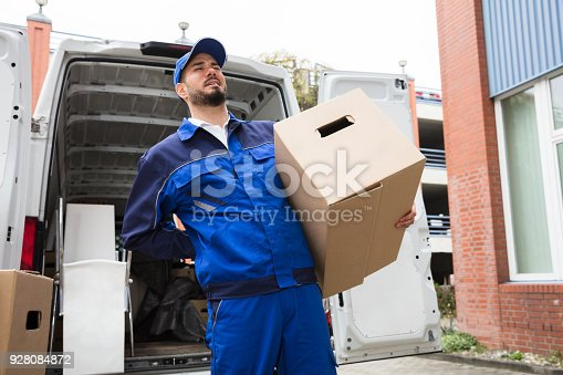 istock Male Worker Carrying Suffering From Backpain 928084872