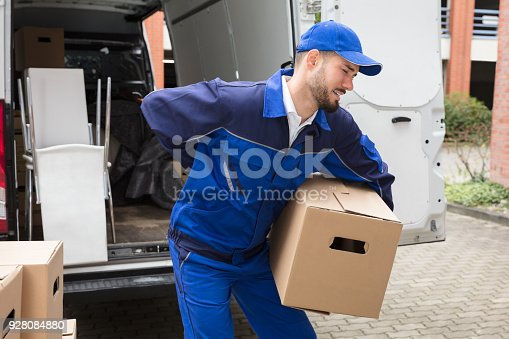 istock Male Worker Carrying Suffering From Backpain 928084880