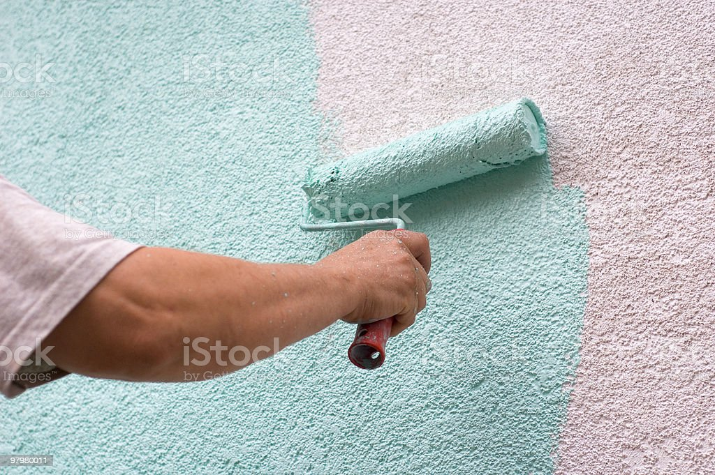 Male worker painting a white wall royalty-free stock photo