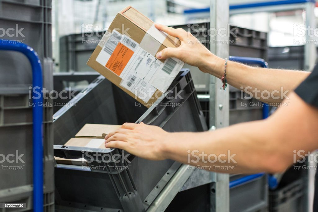 Male worker working in a distribution warehouse stock photo