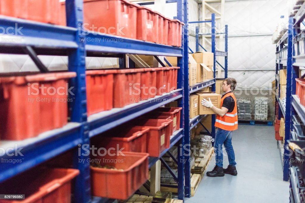 Male worker working in company warehouse royalty-free stock photo