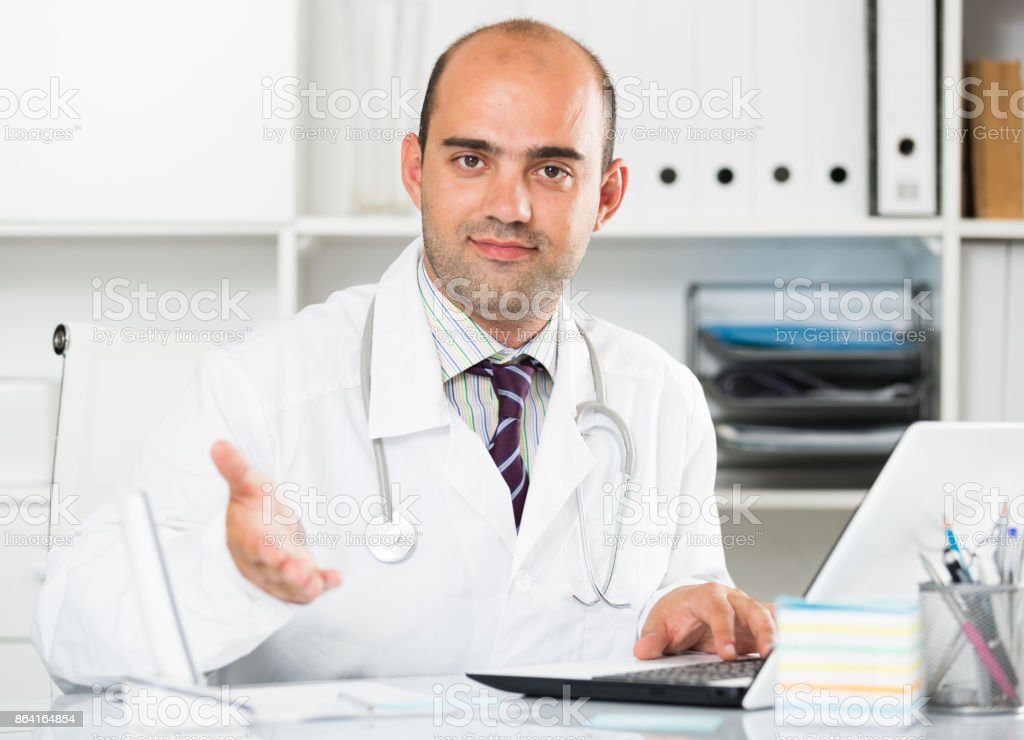Male working in medical Center at the laptop royalty-free stock photo
