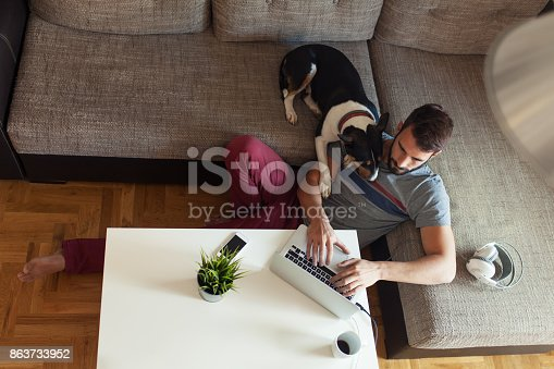 istock Male working on laptop from his home 863733952