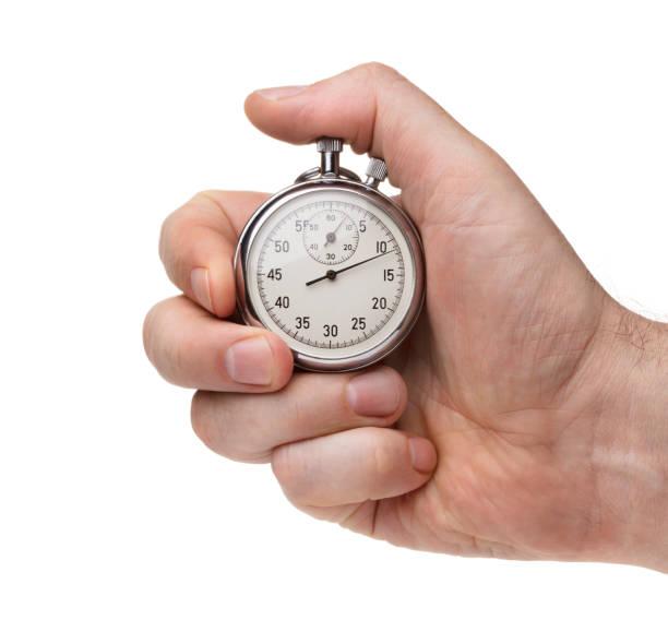 man de hand met stopwatch geïsoleerd op de witte achtergrond - stopwatch stockfoto's en -beelden