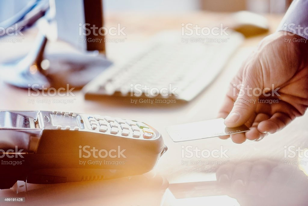 Male's hand using smart card reader stock photo