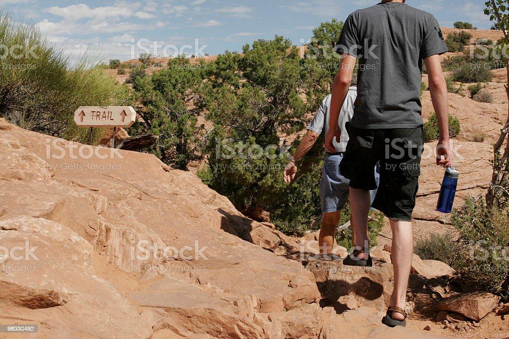 Males walking along a trail royalty-free stock photo