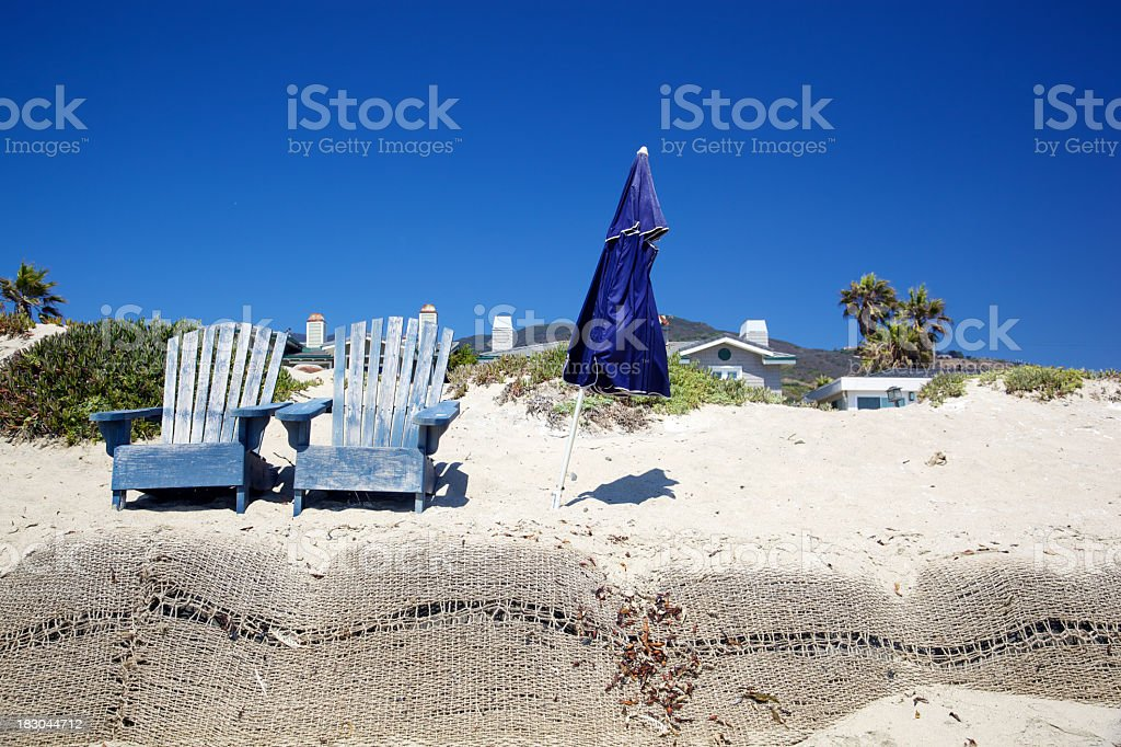 Malibu Beach Erosion Control and Two Chairs stock photo