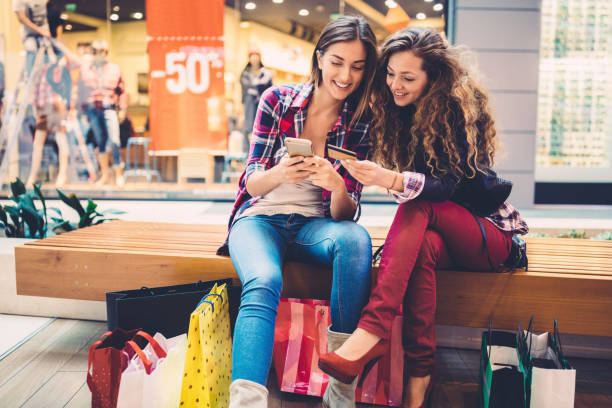 Mall shopping Smiling women shopping online with credit card buying stock pictures, royalty-free photos & images