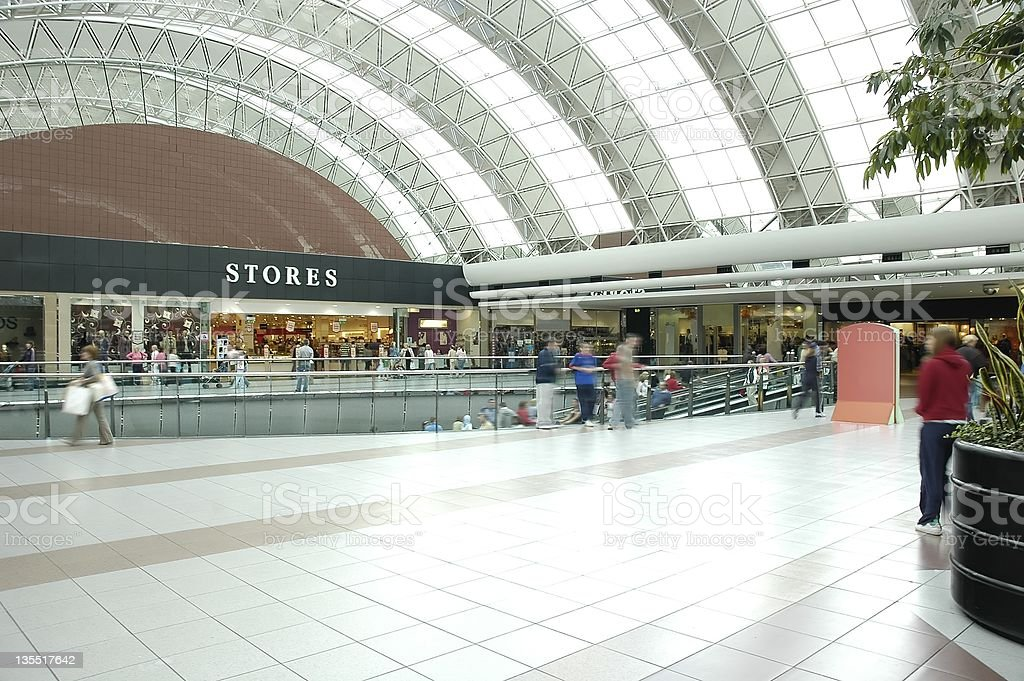 A mall with an arched ceiling and tiled floor royalty-free stock photo