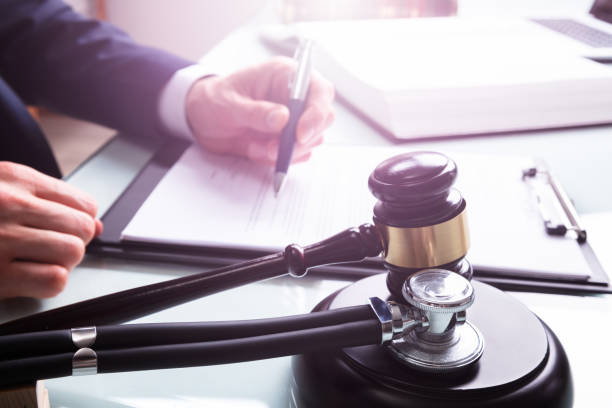 Mallet And Stethoscope Over Sound Block In Court stock photo