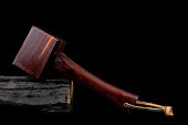 Mallet hammer wood made of rosewood tool handmade of Thailand for used by a carpenter in the workshop on isolated black background