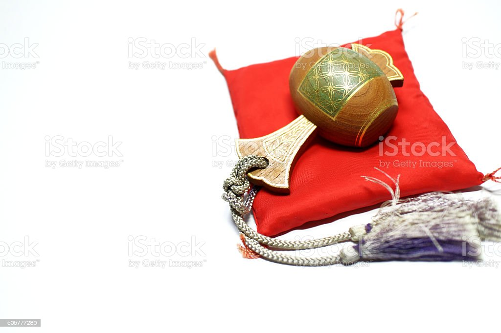 mallet of luck on the red Japanese cushion stock photo