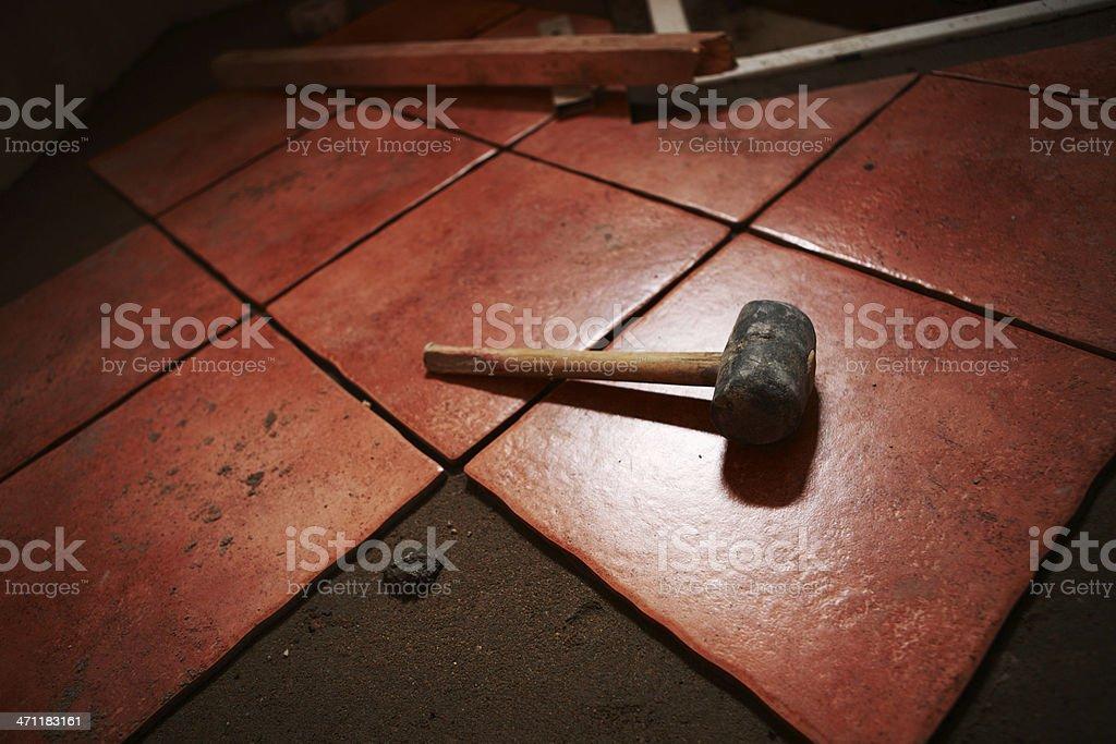 Mallet on Ceramics Tile royalty-free stock photo