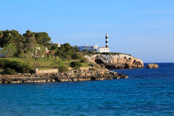 Mallorca, Spain. Porto Colom. Lighthouse. stock photo