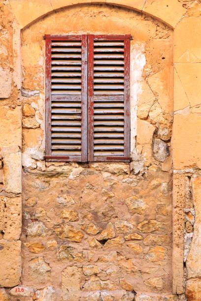 Mallorca, Spain. Wood shuttered window. stock photo