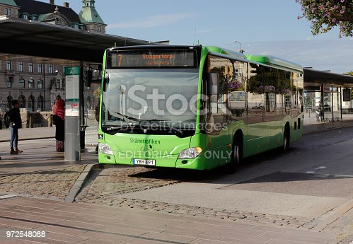 Malmo, Sweden - August 24, 2017: Green city bus in service on line 7 at Malmo central station.