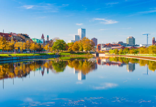 Malmo, Sweden: skyline reflected in the water, urban landscape panorama stock photo