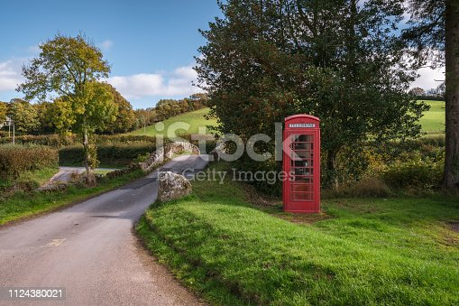 Stone bridge and a telephone booth in Malmsmead, Devon, England, UK