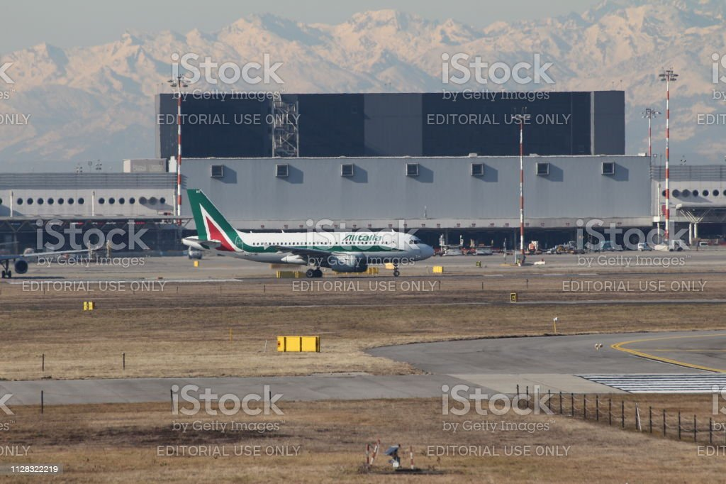 Malpensa Airport Milan Italy 02 06 2019 Alitalia View Over Terminal 1 With Mountains Alps In The Background Stock Photo Download Image Now Istock