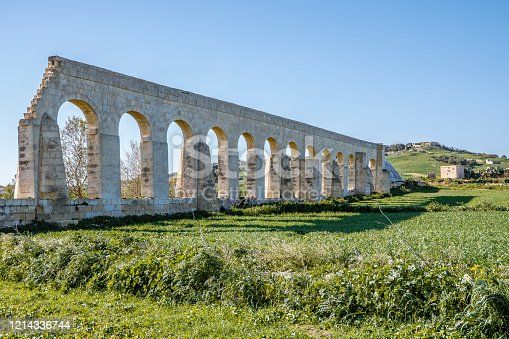 Malta Europe, The Aqueducts on the side of the Victoria in Gozo, maltese landscape with the fresh vegetable field and blue sky background, Malta, Gozo island