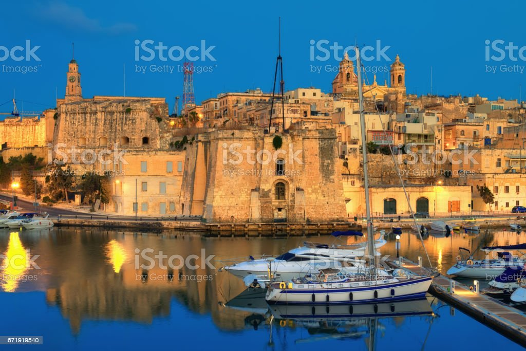 Malta, The Three Cities; a night view to Cospicua stock photo