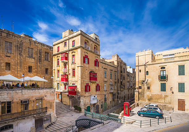 Malta, Valletta - Ancient maltese houses with traditional red balconies stock photo