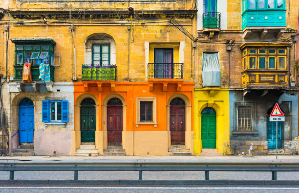 Malta, Valletta: Facade of a residential house with traditional maltese balconies stock photo