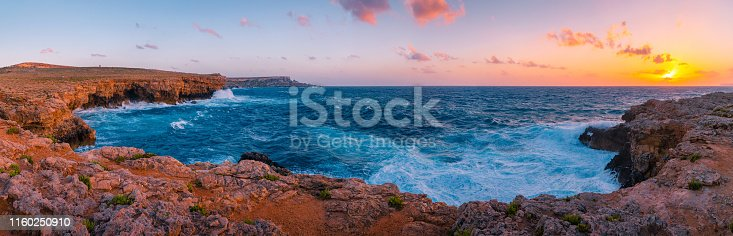 Malta. Maltese coast. Evening with vivid sky over blue sea. Summer panorama with sea. Tropical background.