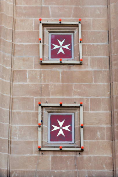 maltese cross is the symbol associated with the order of st. john - knights templar stock pictures, royalty-free photos & images