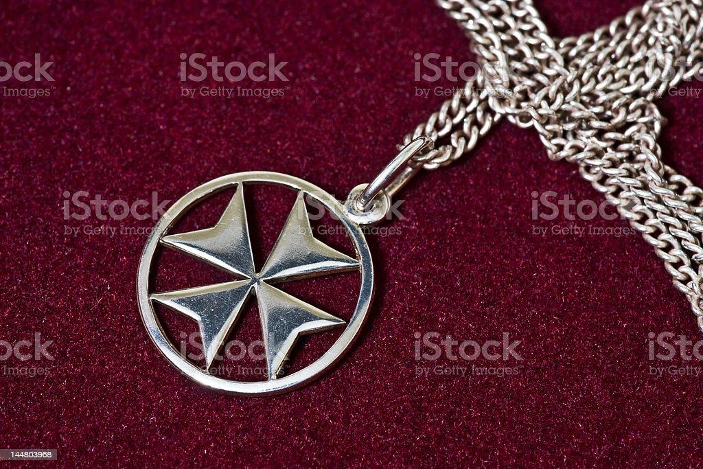 Maltese cross pendant stock photo