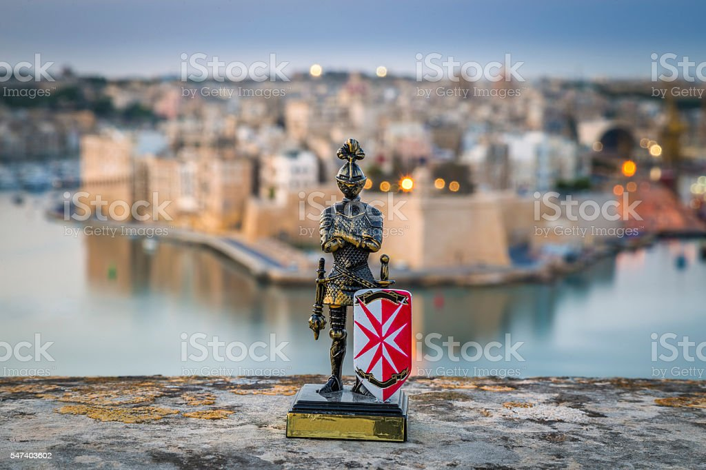 Maltese knight with the island of Birgu in the background stock photo