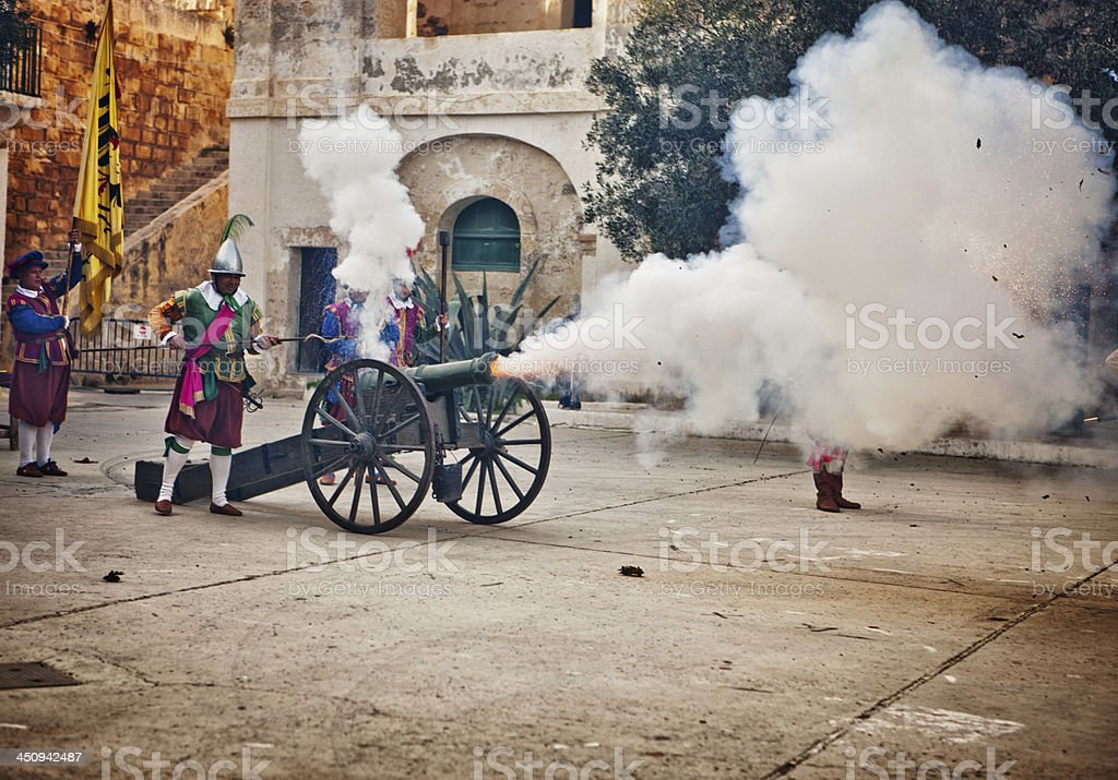 Maltese Knights firing a canon stock photo