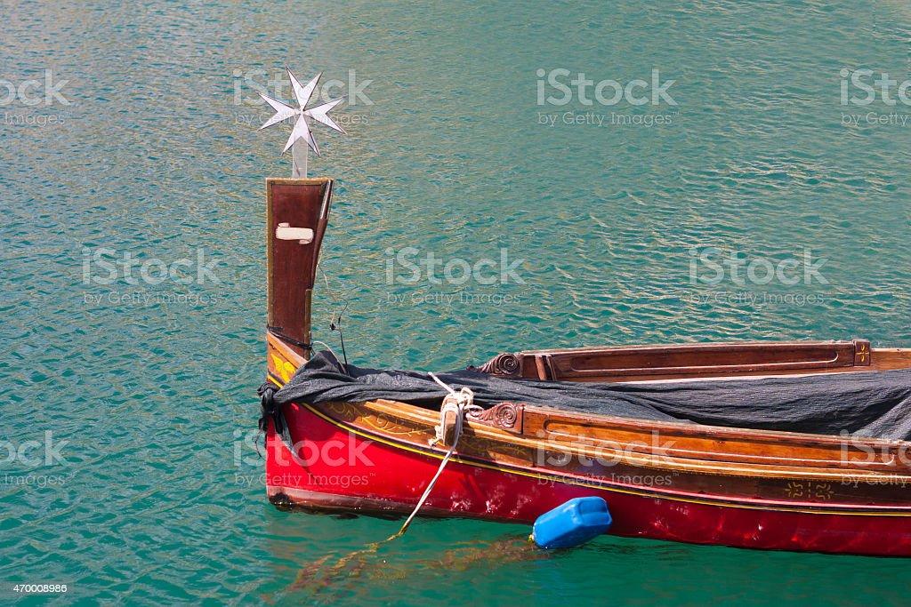 maltese row boat with cross stock photo
