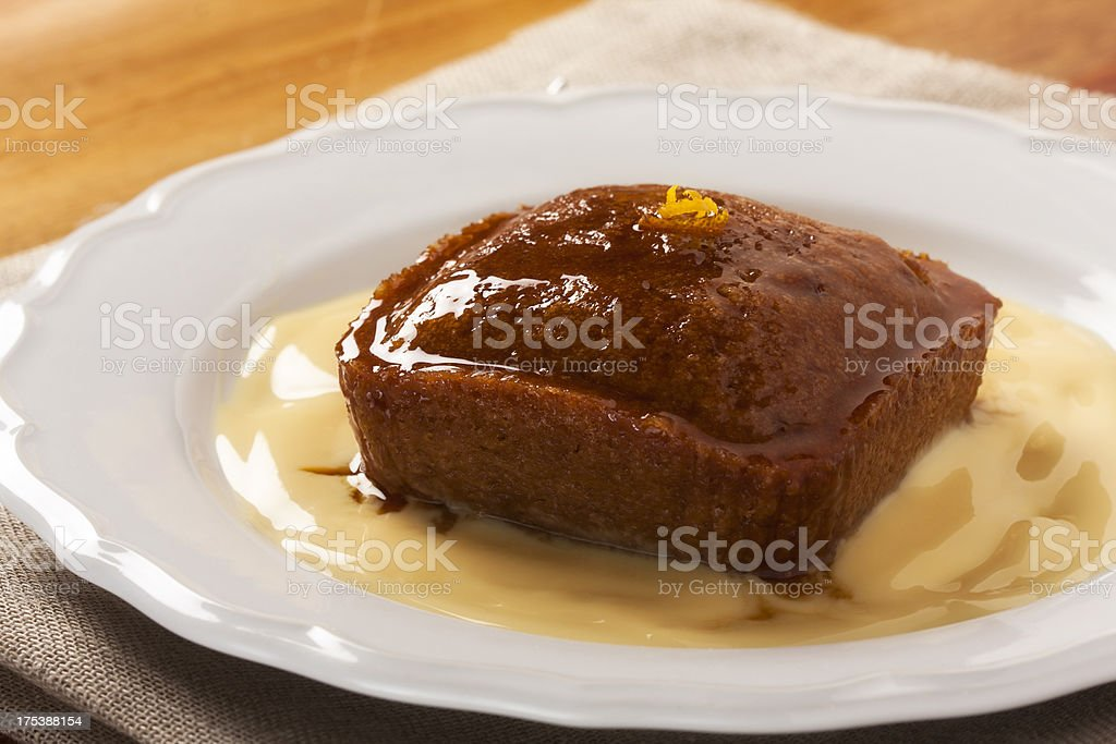 Malva pudding and custard stock photo
