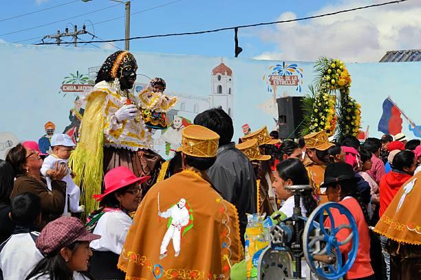 Mama Negra on a horse at traditional Latacunga festival stock photo