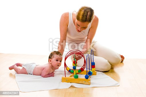 istock Mama playling with newborn baby 485342341