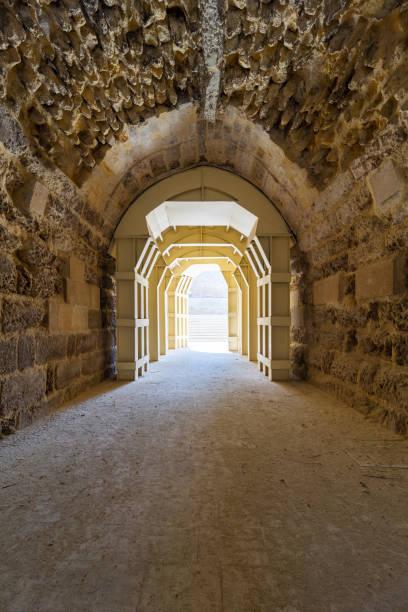 Mamluk era arched stones tunnel leading to Al-Muayyad Bimaristan (ancient hospital), Cairo, Egypt stock photo