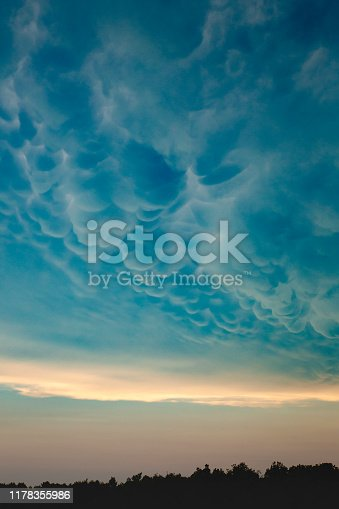 Beautiful mammatus clouds at sunset above forest of Karst plateau (Slovenia).