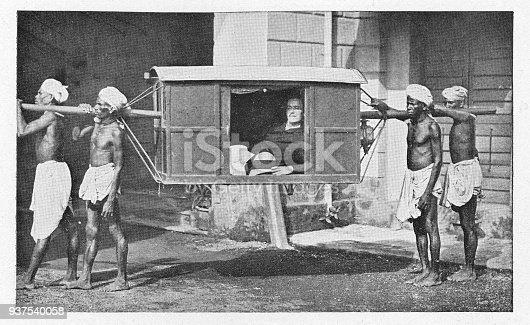 European man aboard a palanquin (sedan-chair/litter) in Delhi, India during the british era. Vintage halftone circa late 19th century.