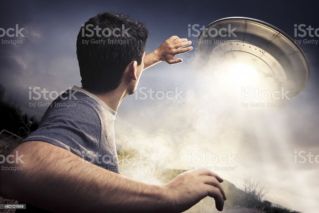 Man about to be abducted by aliens stock photo