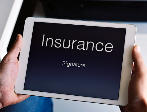 istock man about to sign an insurance policy 826015678