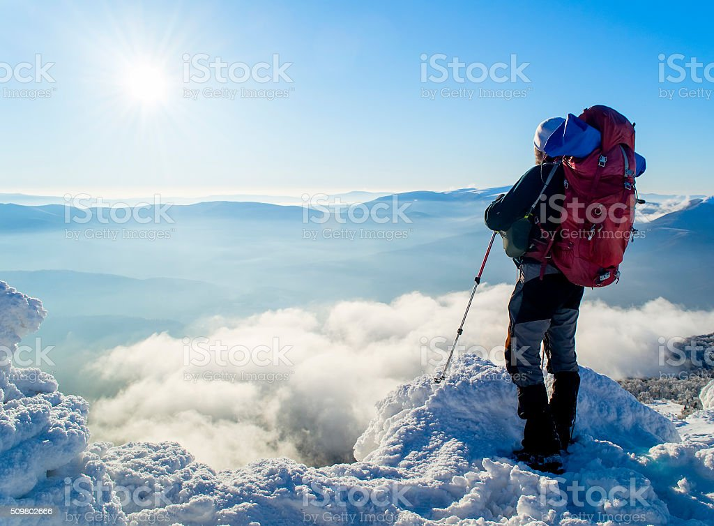 Man above the clouds stock photo