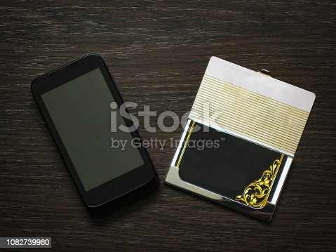 istock Man accessories in business style with gadgets, sunglasses, watch, cards and other luxury attributes on wooden background. Casual, office or fashion style. Blank place, mockup for text message - Image 1082739980
