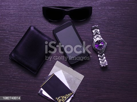 istock Man accessories in business style with gadgets, sunglasses, watch, cards and other luxury attributes on wooden background. Casual, office or fashion style. Blank place, mockup for text message - Image 1082740014