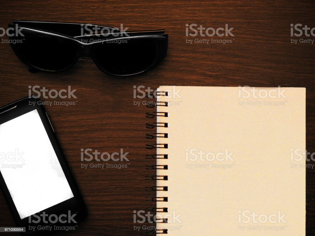 Man accessories in business style with gadgets, sunglasses, watch, cards and other luxury attributes on wooden background. Casual, office or fashion style. Empty blank place, mockup for your text message or media content stock photo
