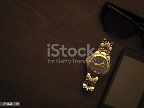 istock Man accessories in business style with gadgets, sunglasses, watch, cards and other luxury attributes on wooden background. Casual, office or fashion style. Empty blank place, mockup for your text message or media content 971031276